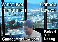 Robert Y.C.. Leong, in office with view of Vancouver BC  Falsecreek
